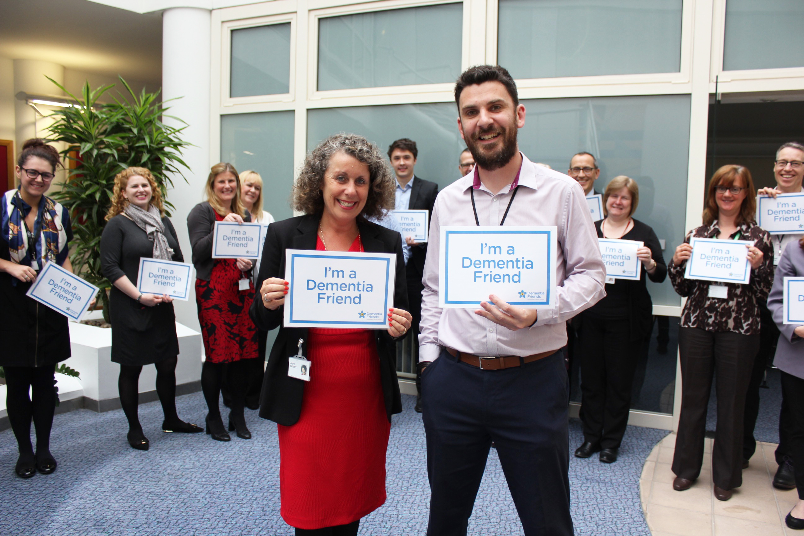 Staff from Phoenix Group showing support for Dementia Friends